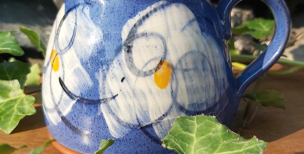 Pretty studio pottery daisy mug