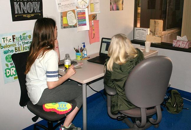 Two Bridge Builder Academy students sharing laptop