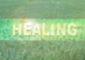 the word _ Healing _ design by white letterpress on painted and rice green field background