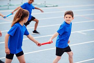 children-in-athletics-team-competing-in-