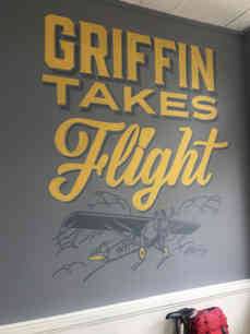 Hand painted mural in Griffin, Georgia for Wovenhouse Media