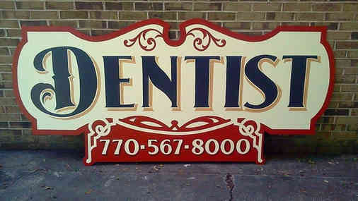 Hand painted sign for a dentist in Zebulon, GA