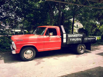 Hand painted sign for a lumber truck in Barnesville, GA