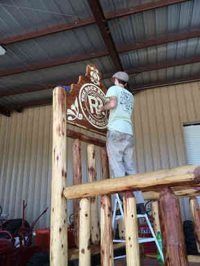 Hand painted sign on a large rocking chair for the Rock Ranch in The Rock, GA