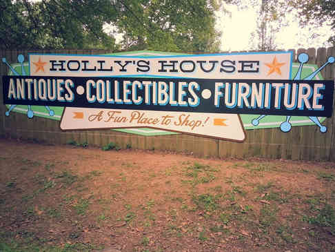 Hand painted sign for an antique mall in Griffin, GA