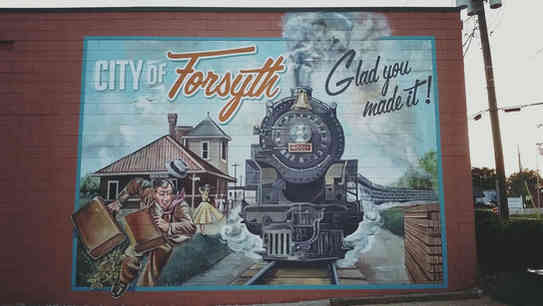 Hand painted mural of a train for Forsyth, GA