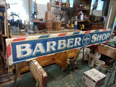 Hand painted barber shop sign for a man in Barnesville, GA