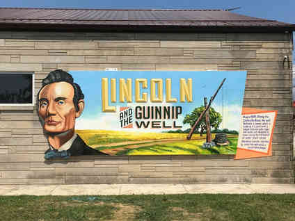 Hand painted mural for the community in Marshall, Illinois highlighting local history