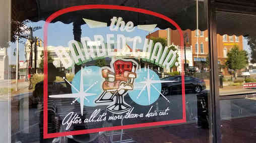 Hand painted window sign for a barber shop in Barnesville, GA