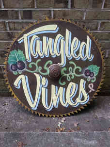 Hand painted sign on a saw blade