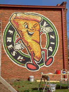 Hand painted mural -  the logo was designed by Shannon Lake