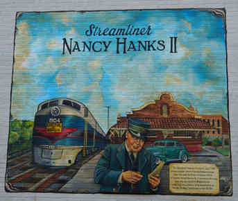 Hand painted mural highlighting the history of Barnesville, Georgia and the trail of the Nancy Hanks II train