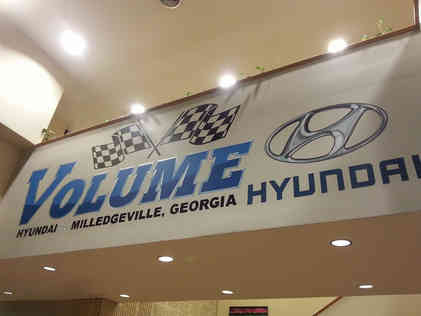 Hand painted corporate logo application in a car dealership located in Milledgeville, GA