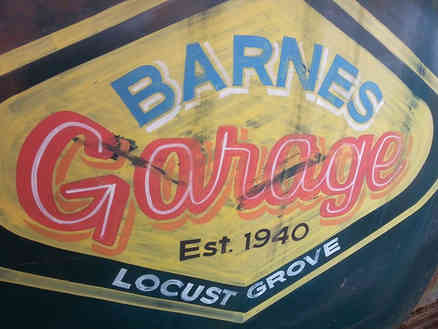 Hand painted sign on a truck door for a lady in Barnesville, Georgia about Locust Grove, GA