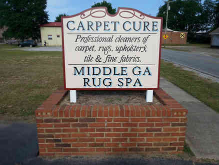 Hand painted and installed sign for a business in Barnesville, GA