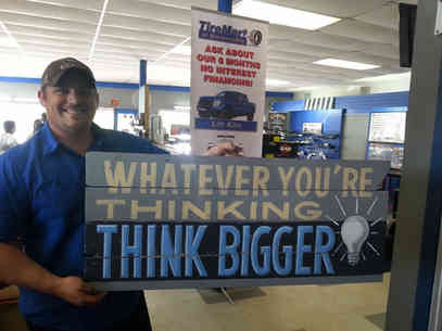 Custom painted sign with a quote