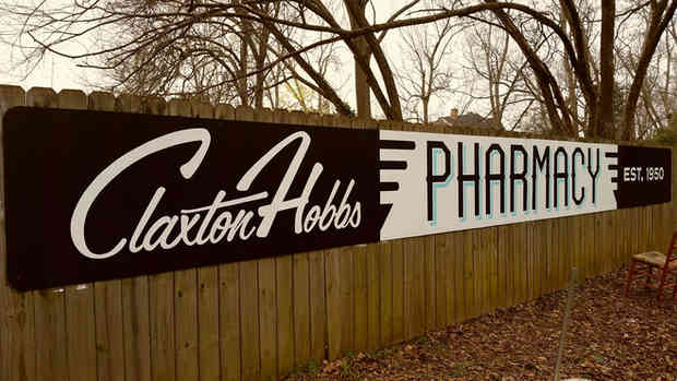 Hand painted sign for Claxton Hobbs Pharmacy in Griffin, GA