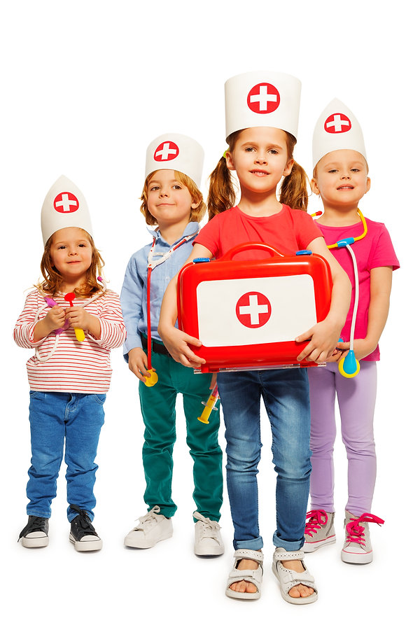 Little doctors with medical box giving f