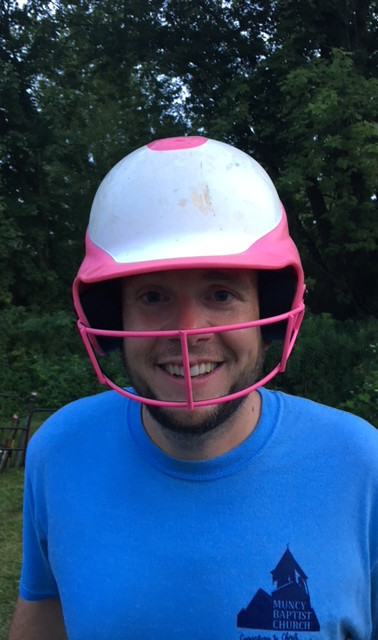 Pastor Rob wearing a helmet AFTER he was hit in the lip with a softball (while catching). Nice catch though!
