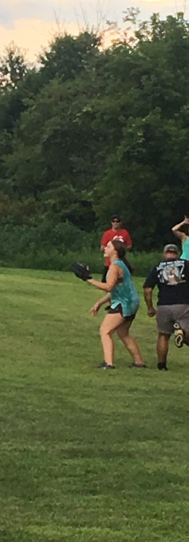 Kaylyn on first base, getting ready to tag the Wesleyans out.