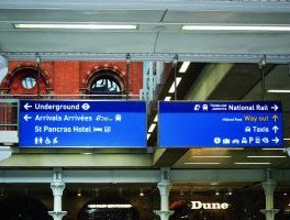 Double sided lighting solution for wayfinding signs