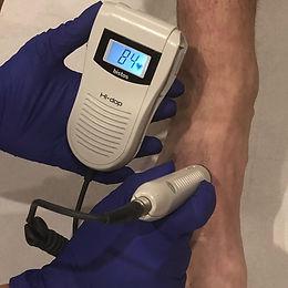 podiatrist chiropodist using a doppler at Deva Podiatry Foot Health Clinic Chester