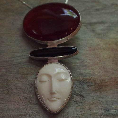 Carnelian and black onyx face pendant