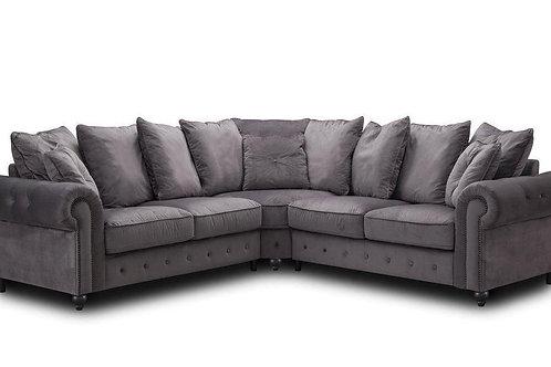 Grey corner sofa with button detail