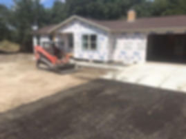 New driveway and concrete sidewalk