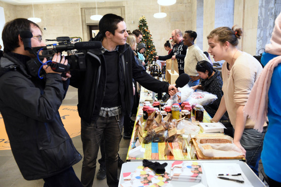 Filming crew interviewing stall holders