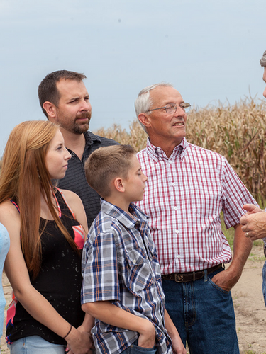 RDB talking to family-corn in background