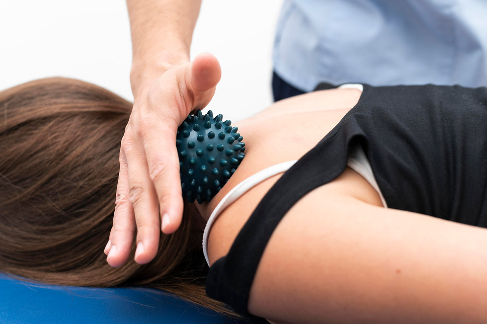 woman-getting-massage-from-physiotherapi