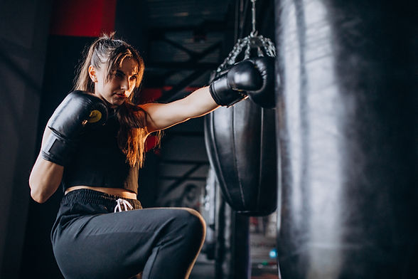 young-woman-boxer-training-gym.jpg