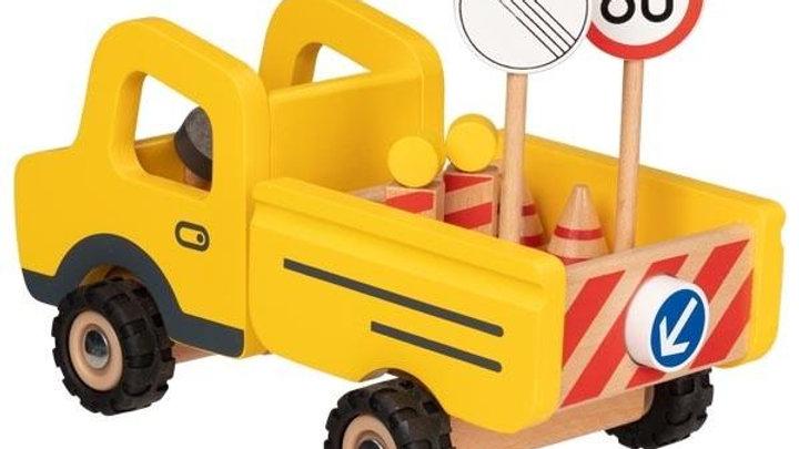 Baufahrzeug mit Verkehrszeichen