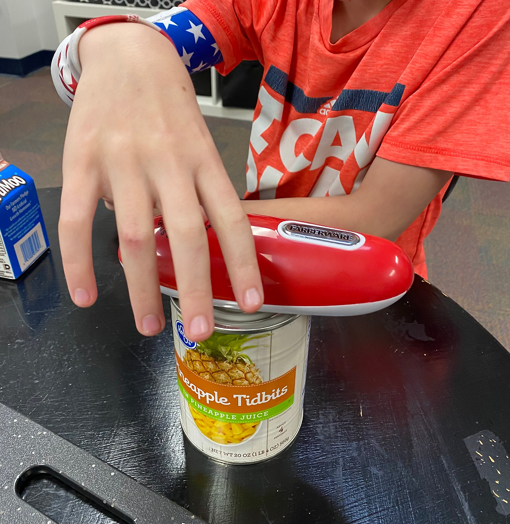 Student uses can opener
