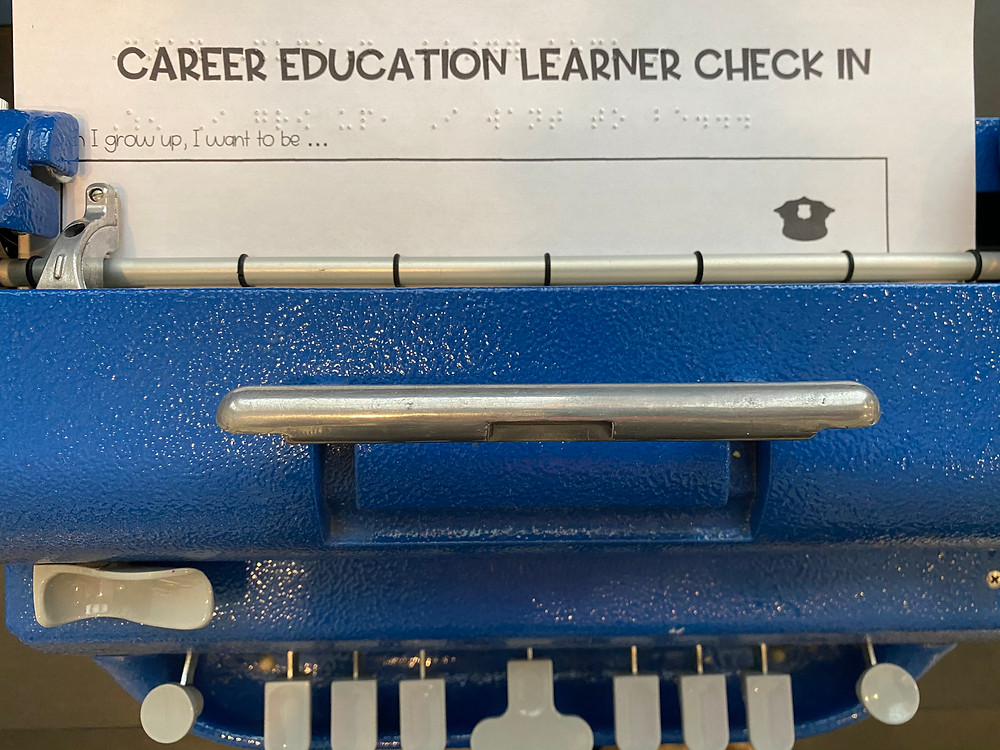 """image of perkins brailler with """"Career Education Learner Check In"""" paper inside."""
