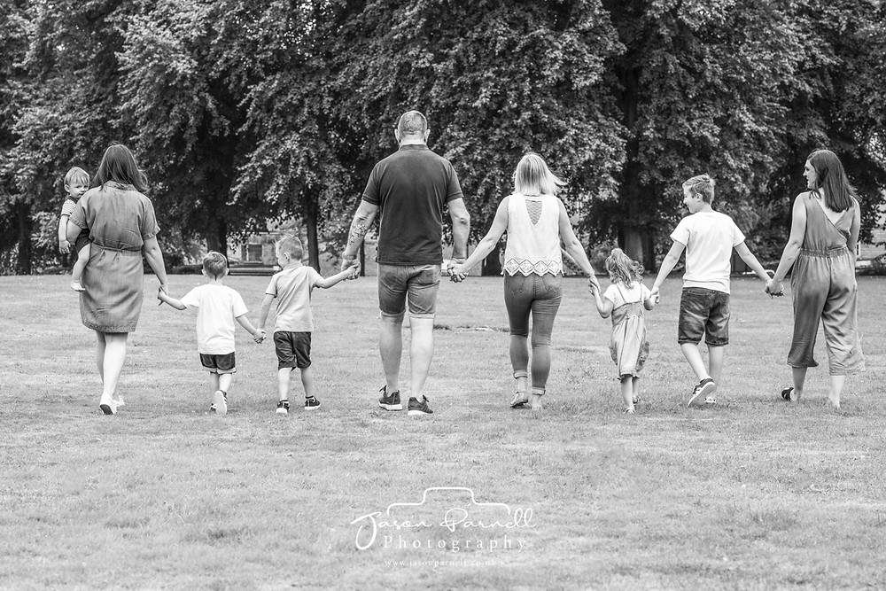 family holding hands walking in Carr Bank Park