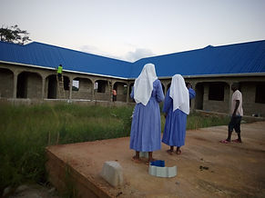 Sisters in front of new nursery school