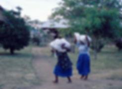 Sisters Carrying Sacks on Head