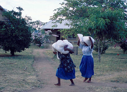 Sisters Carrying Sacks on Head