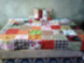 Patchwork quilt on bed