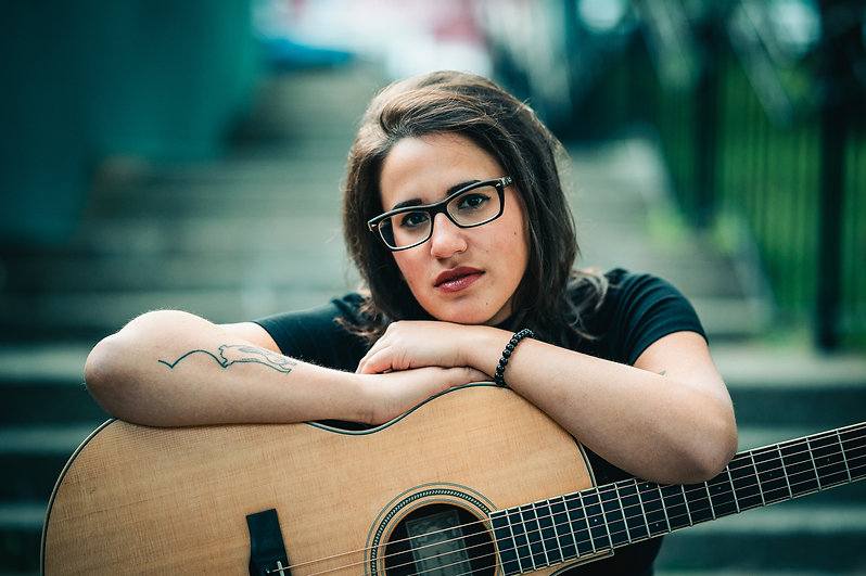 REA jazz /indie pop singer-songwriter guitar rabbit tattoo