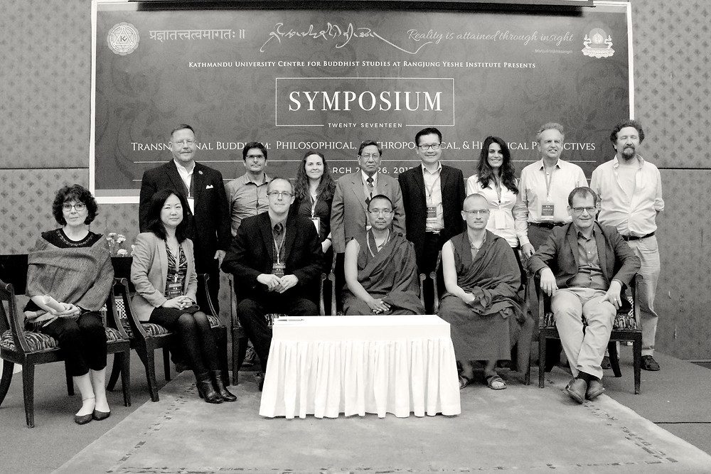 Symposium Speakers gather for a final photo op.