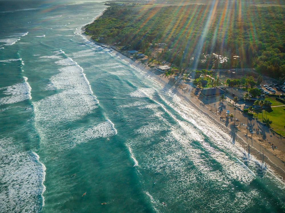 Surfers at White Plains Beach.