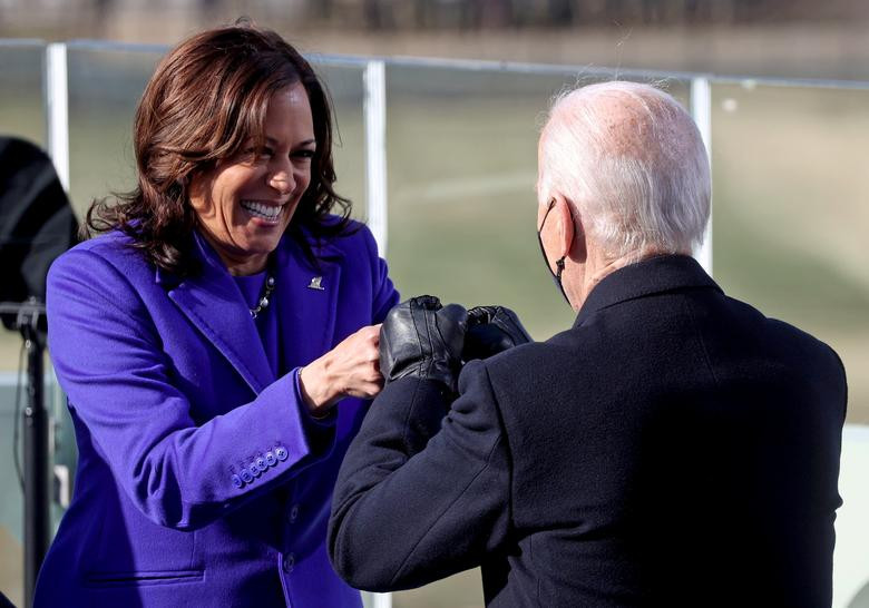 Vice President Kamala Harris and President Joe Biden doing a fist bump after being sworn in on inauguration day