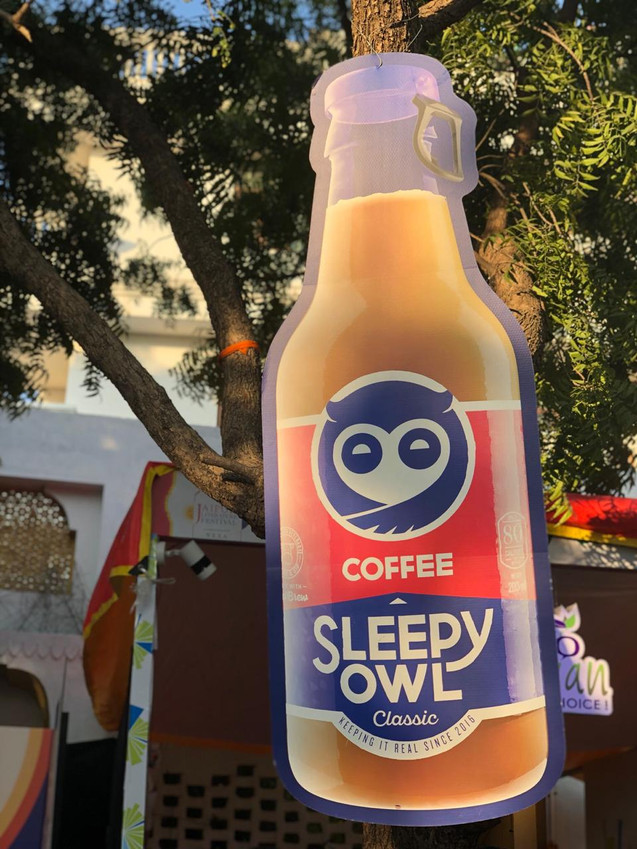 Giant Coffee Bottle Cutout for Sleepy Owl Coffee
