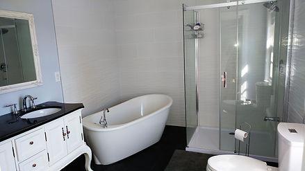 Relist Renos, Burlington, Bath, Lounging tub, double sink vanity, wide glass shower, white wave tiles, anti-slip tiles