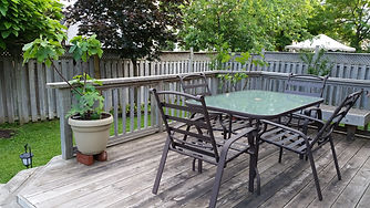 drab weathered deck, soft spots, nesting animals, wood slivers, needs repair and refresh, relist renos, burlington, hamont
