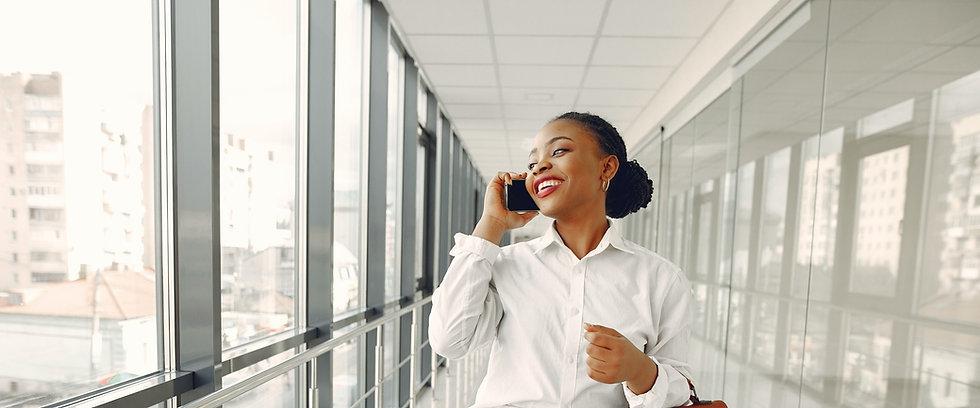 cheerful-woman-talking-on-smartphone-in-