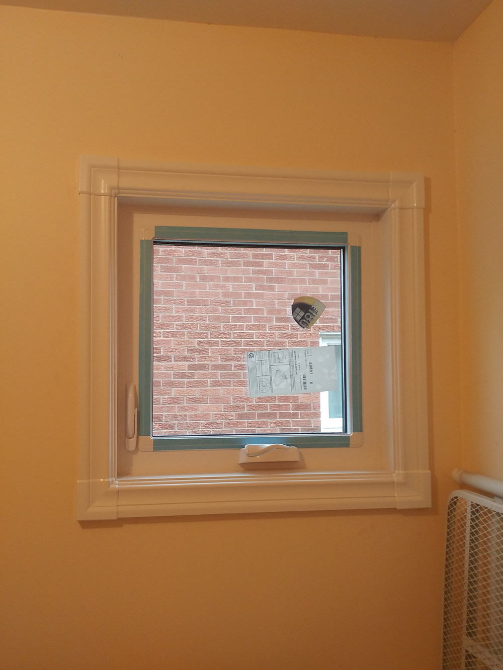 Vinyl window with vinyl casing
